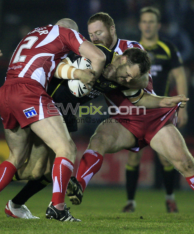 Pix: Chris Mangnall/SWpix.com, Rugby League, Super League. 15/02/08. Salford City Reds v Celtic Crusaders....picture copyright>>Simon Wilkinson>>07811267 706>>....Salford's Rob Parker   and craig Stapleton tackle Celtic Crusaders's Mark bryant
