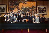 26 Sep 1984, Hong Kong, China --- Sir Richard Evans and the People's Republic of China (PRC) representative in Hong Kong, Zhou Nan, during the signing of the agreement between Great Britain and the PRC in the restoration of Hong Kong as Chinese territory. --- Image by © JP Laffont