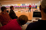 "Ben takes a turn at bowling as (counterclockwise) Keith, Timmy, Sheila and Mark look on. Such public outings were not possible when living with the four other residents at Curt's home. ""I had thought about options and ways we might have kept that entire group together,"" says Mark of the seven men that lived with Curt. ""But as you think about it a little more, you realize that sometimes it is time for certain people to move on, because they're able to. They're able to live in a less restrictive setting."""