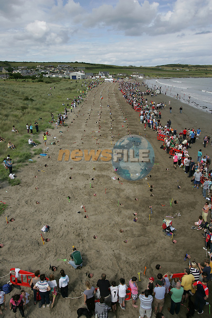 522 people buries in the sand to make the new Guinness world record as part of  the clogherhead prawn festival ..Picture Fran Caffrey/www.newsfile.ie