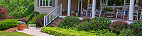 Curb appeal: Landscaping to House front porch garden with walkway path, hanging plants, shrubs and Viola and pachysandra groundcovers, lawn grass