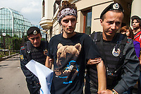 17/08/2012, Moscow, Russia..Police seize a protester outside the court as Maria Alyokhina, Yekaterina Samutsevich and Nadezhda Tolokonnikova of punk band Pussy Riot are sentenced to two years in prison for their performance in the Christ The Saviour Cathedral.