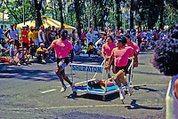 EDITORIAL ONLY. Contestants in the annual Carole Kai Bed Race, benefit run in Waikiki