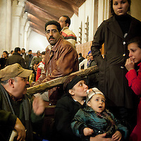 Egypt / Cairo / 18.3.2012 / A Coptic family in the Cathedral: thousands of grieving Copts flocked to St Mark's Coptic Cathedral in Abbasseya on March 18th, for visiting Pope Shenouda III, the spiritual leader of the Middle East's largest Christian minority, died the 17th of March. Three persons have been crushed to death and 137 injured near the St Mark's Coptic Cathedral the evening of the 18th, first day of exhibition of the body of the Pope. Pope Shenuda III died at the age of 88, after a long battle with illness and based on his wishes he had been buried on March 20, at St. Bishoy monastery in Wadi Natrun in the Nile Delta where he spent his time in exile after a dispute with late president Anwar Sadat. Cairo, Egypt. March 18th, 2012.