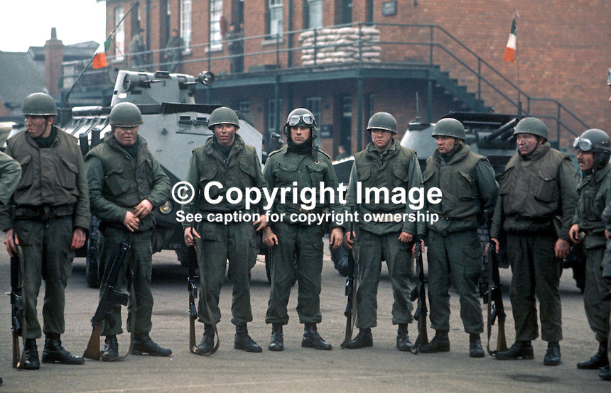 Irish Army personnel of the 23rd Battalion stationed in Dundalk wait to be briefed before going on patrol in Co Louth along the border with Co Armagh, N Ireland. 197512120773c..Copyright Image from Victor Patterson, 54 Dorchester Park, Belfast, United Kingdom, UK...For my Terms and Conditions of Use go to http://www.victorpatterson.com/Victor_Patterson/Terms_%26_Conditions.html