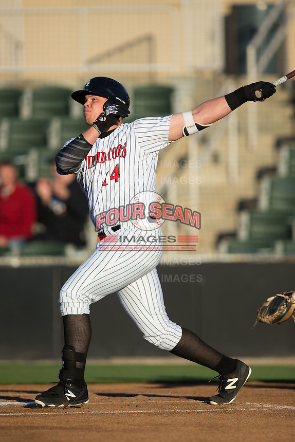 Corey Zangari (14) of the Kannapolis Intimidators follows through on his swing against the Hagerstown Suns at Kannapolis Intimidators Stadium on May 6, 2016 in Kannapolis, North Carolina.  The Intimidators defeated the Suns 5-3.  (Brian Westerholt/Four Seam Images)