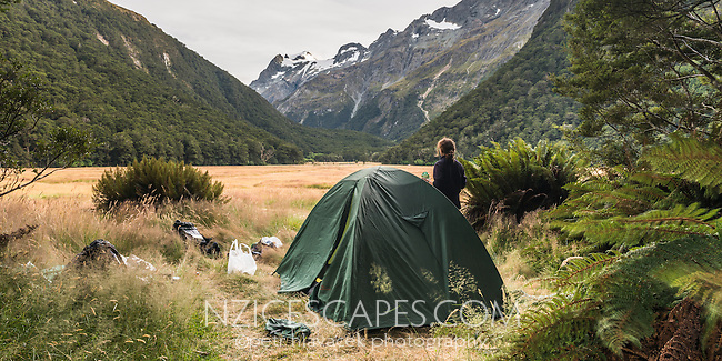Female tramper camping at Routeburn Flats on Routeburn Track, Mt. Aspiring National Park, UNESCO World Heritage Area, Central Otago, New Zealand, NZ