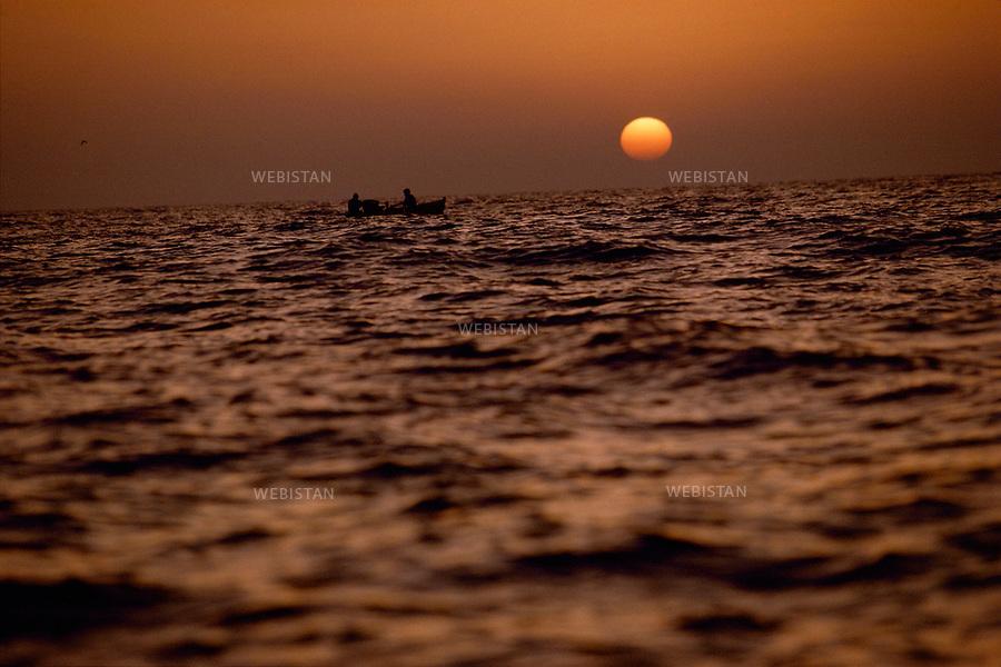 Egypt. Abukir. 1996. Egyptian fishermen at sunset on the Mediterranean Sea..Egypte. Abukir. 1996. Pecheurs egyptiens au coucher de soleil sur la Mediterranee..
