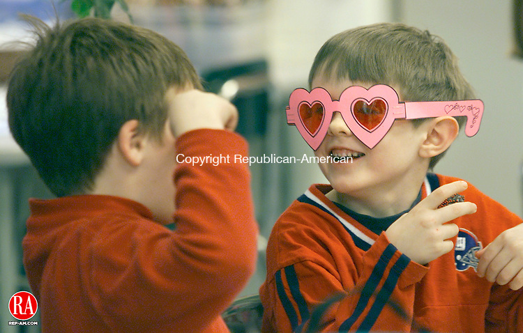 MIDDLEBURY, CT- 2/14/01- 0214BZ01.tif- Ryan Gobstein, 7, and Taylor Ellsworth,6, (right) clown around with Valentines Day glasses while participating in a party in their class at Long Meadow Elementary School.<br /> For metro.<br /> JAMISON C. BAZINET PHOTO