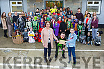 Castleisland Boys NS school Held a fancy dress fundraiser for Currow boy Shane Brosnan. Pictured principal Marina O'Connor  and Rohan O'Sullivan presented Shane Brosnan with staff a pupils on Friday