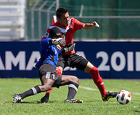Sadi Jalali (9) of Canada tries to get past Quesi Weston (1) of Trinidad & Tobago during the quarterfinals of the CONCACAF Men's Under 17 Championship at Catherine Hall Stadium in Montego Bay, Jamaica. Canada defeated Trinidad & Tobago, 2-0.