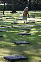 An elderly German woman visits Vladsio German Military Cemetery in Vladsio, West Flanders, Belgium, August 27, 2014. 2014 marks 100th anniversary of World War I.