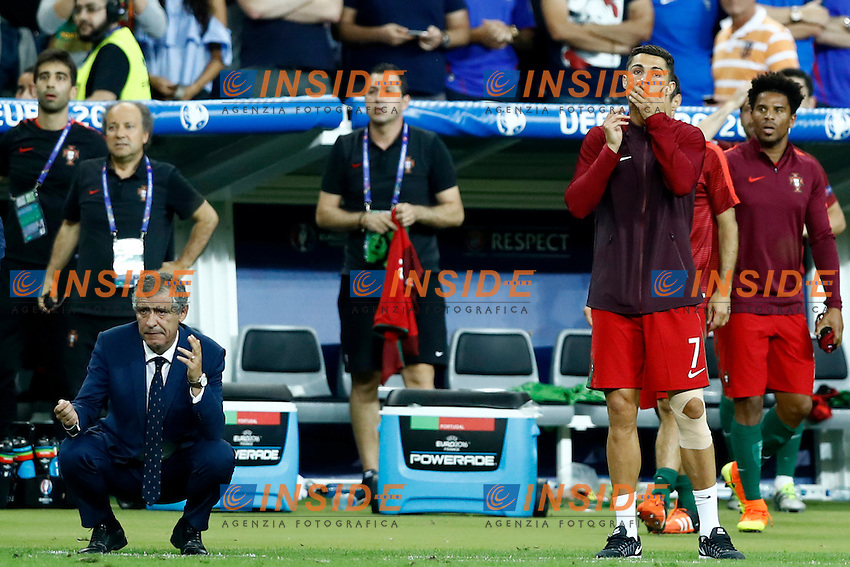 Cristiano Ronaldo (Portugal) suffering with Portugal coach Fernando Santos during the extra times after the knee injury. sofferenza supplementari in panchina dopo infortunio ginocchio<br /> Paris 10-07-2016 Stade de France Football Euro2016 Portugal - France / Portogallo - Francia Final / Finale <br /> Foto Matteo Ciambelli / Insidefoto