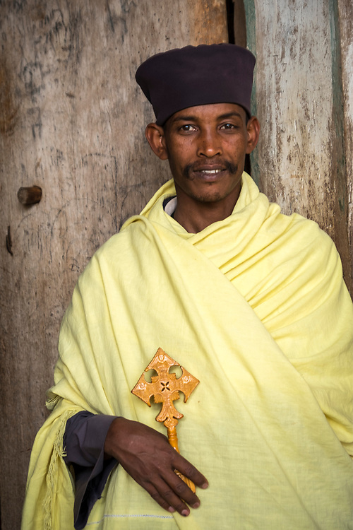 Attending an ancient Lake Tana monastery, this orthodox priest holds a striking version of the Ethiopian crucifix.