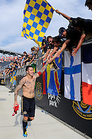 Danny Califf (4) of the Philadelphia Union celebrates with fans after the game. The Philadelphia Union defeated Toronto FC 2-1 on a second half stoppage time goal during a Major League Soccer (MLS) match at PPL Park in Chester, PA, on July 17, 2010.
