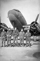 BNPS.co.uk (01202 558833)<br /> Pic: HannBooks/BNPS<br /> <br /> PICTURED:  Paratrooper, Stanley Hann  (far left) with his SAS party before take off.<br /> <br /> Remarkable photos taken deep behind enemy lines by an SAS unit during a daring wartime operation have come to light on the 75th anniversary of the mission. <br />  <br /> The little-known Operation Galia on the 27th December 1944 involved just 33 SAS men hoodwinking the Nazis and their fascist allies into thinking a much greater force had landed behind them in Italy in December 1944.<br />  <br /> Adolf Hitler's forces had just launched a major surprise offensive in the Ardennes Forest in Belgium that became known as the Battle of the Bulge.<br /> <br /> Robert Hann, whose late father was SAS Paratrooper Stanley Hann, retraced his father's wartime experiences and part of his [father's] epic 80 mile long escape route through the Apennine mountains which the men took, to help him write the book 'SAS Operation Galia.'
