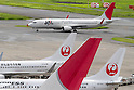 September 19, 2012, Tokyo, Japan - A Japan Airlines jetliner taxis down the tarmac at Tokyo's Haneda Airport on Wednesday, September 19, 2012...Once the national flag carrier, JAL was delisted after going bankrupt in 2010. It has since carried out cost cuts and restructured, returning to solid profitability. JAL shares rose about 2 percent on their return to the stock market  following a 663 billion yen ($8.5 billion) initial public offering that nearly doubled the money that went into the once-bankrupt carrier's bailout. (Photo by AFLO) UUK -mis-.