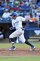 Asheville Tourists designated hitter Yonathan Daza (2) swings at a pitch during a game against the Augusta GreenJackets at McCormick Field on August 5, 2016 in Asheville, North Carolina. The Tourists defeated the GreenJackets 7-6. (Tony Farlow/Four Seam Images)