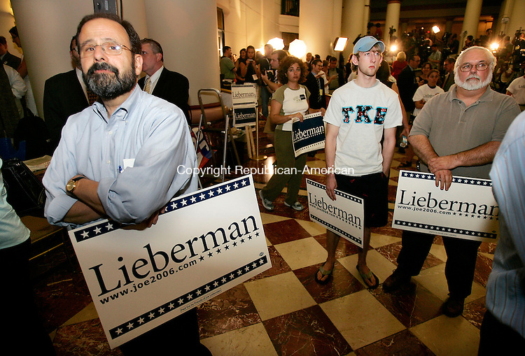 HARTFORD, CT. 08 June 2006--080806SV07--At left, Louis Goldberg of New Haven watches as results come in for U.S. Sen. Joseph Liberman while being defeated by Greenwich businessman Ned Lamont in the democratic primary in Hartford Tuesday.<br /> Steven Valenti Republican-American