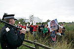 Climate change protesters at Climate Camp, Heathrow make their way to the BAA offices but are met by riot police.<br />