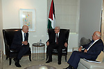 Palestinian President Mahmoud Abbas, meets with Ehud Olmert, the former Israeli Prime Minister, in New York, United States on February 11, 2020. Photo by Thaer Ganaim