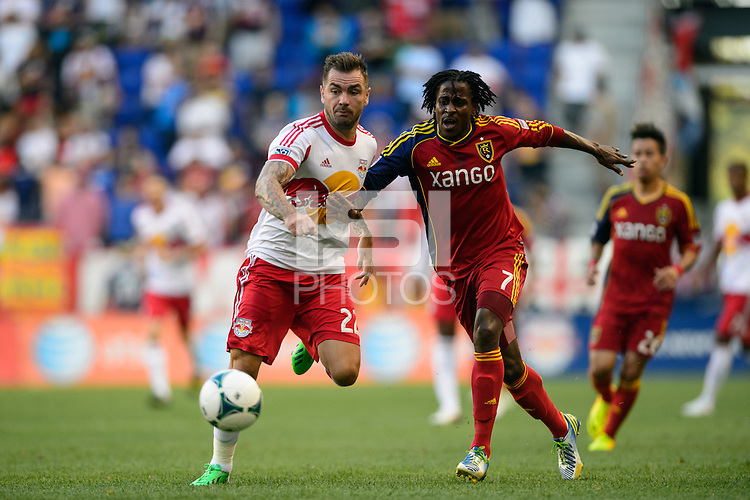 Jonny Steele (22) of the New York Red Bulls and Lovel Palmer (7) of Real Salt Lake. The New York Red Bulls defeated Real Salt Lake 4-3 during a Major League Soccer (MLS) match at Red Bull Arena in Harrison, NJ, on July 27, 2013.