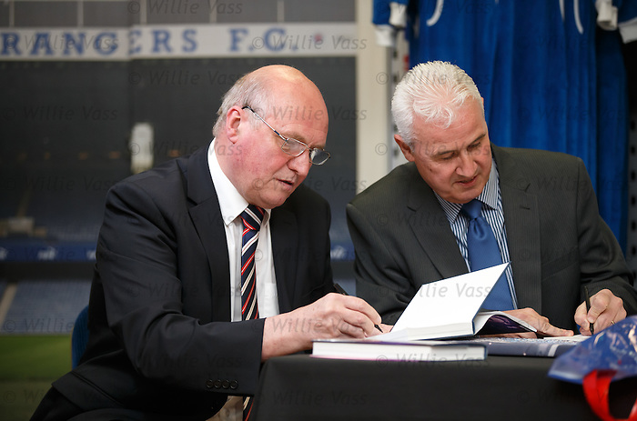 "Colin Stein and John MacDonald signing copies of the Jock Wallace book ""Blue Thunder"" at the Rangers Megastore"