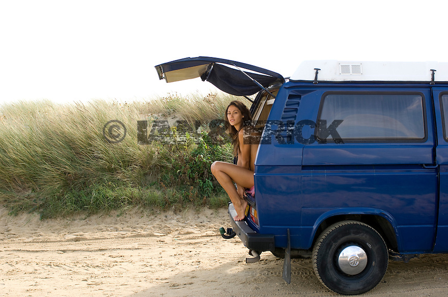 Sarah Godard at the back of a Combi van in Capebreton in the south of France.