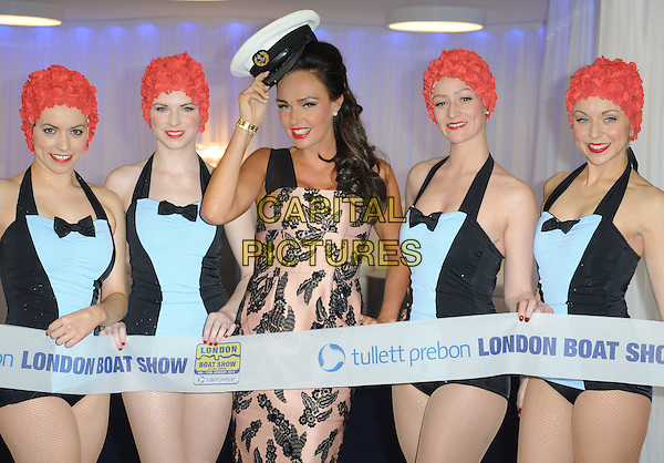 Tamara Ecclestone opens the 'London Boat Show 2012' at the Excel Centre, Custom House, London, England..January 6th, 2012.half length white hat pink black lace dress ribbon wig red swimsuit bathing suit gold bracelet hand.CAP/WIZ.© Wizard/Capital Pictures.