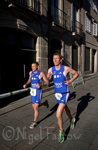 25 JUN 2011 - PONTEVEDRA, ESP - Gerard Bourdillon and Michael Pinkney (both GBR) run through the streets of the old town during European Age Group Sprint Triathlon Championships .(PHOTO (C) NIGEL FARROW)