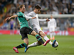 Real Madrid's forward Alvaro Morata vies with Benedikt Howedes uring the UEFA Champions League football match Real Madrid CF vs Schalke 04 FC at the Santiago Bernabeu stadium in Madrid on March 18, 2014.  PHOTOCALL3000/ DP