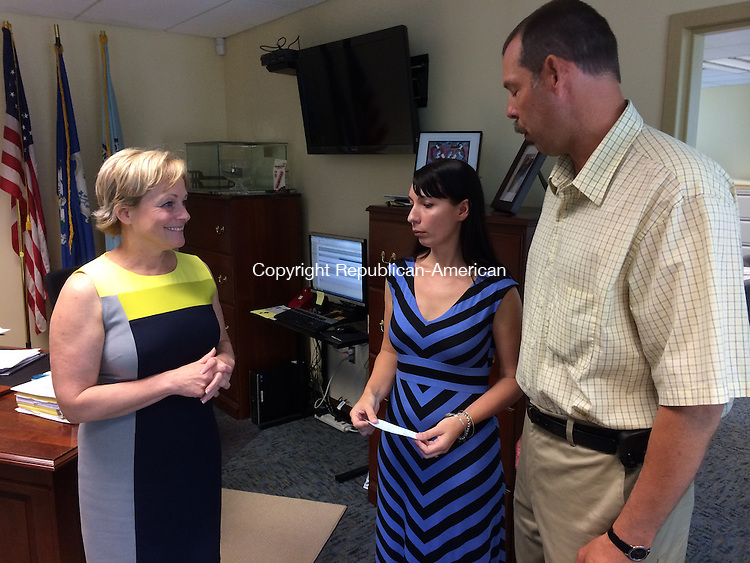 TORRINGTON, CT - 20 JUNE 2014 -- Mayor Elinor C. Carbone on Friday accepts a donation for the flag fund from Chrissy Upton and Mark Zordan, representing a local union, Alec Johnson/ Republican-American