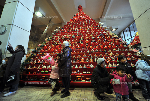 "February 12, 2012, Konosu, Japan - A huge pyramid of Japanese dolls adorns the city hall lobby for Girls' Festival in Konosu, Saitama prefecture on Wednesday, February 12, 2012. .The city, located some 40km north of Tokyo, is known as ""Doll Town"" for a number of factories making ""Hina Ningyo,"" Japanese dolls, and retailers. The doll manufacture in Konosu has about 380 years of history. Tradition calls upon families with daughters for putting out these dolls for the Girls' Day on March 3 with the hopes that they grow up healthy and happy. (Photo by Natsuki Sakai/AFLO) [3615] -ks-"