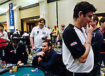 Alex Brenes ponders making a call of Dario Minieri's all in.  He did and won the hand, knocking Minieri out on the money bubble.
