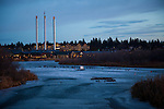 Canadian Geese on a frozen river in downtown Bend, Oregon at dusk