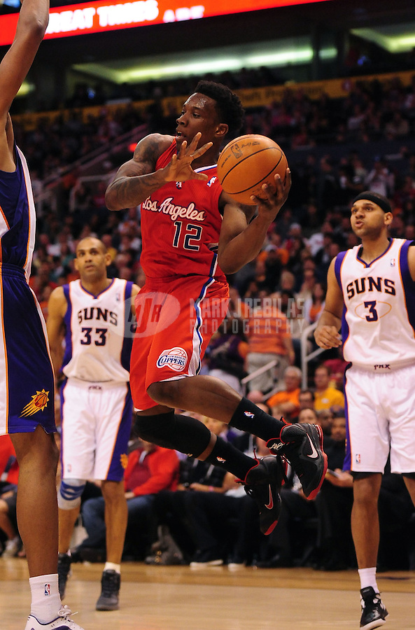Mar. 2, 2012; Phoenix, AZ, USA; Los Angeles Clippers guard Eric Bledsoe passes the ball under pressure during game against the Phoenix Suns at the US Airways Center. The Suns defeated the Clippers 81-78. Mandatory Credit: Mark J. Rebilas-USA TODAY Sports