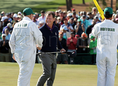 08.04.2016. Augusta, GA, USA - Tom Watson shakes hands with his caddie, Neil Oxman, as Brett Waldfman, caddie for Charley Hoffman, looks on at the 18th green, during Watson's final Masters appearance, in the second round of the 80th Masters at the Augusta National Golf Club on Friday, April 8, 2016, in Augusta, Ga