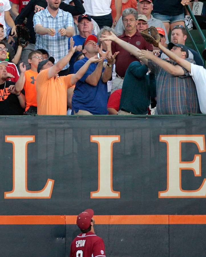 Virginia fans catch the home run ball hit by Virginia's outfielder Mike Papi (38) as Arkansas outfielder Tyler Spoon (8) watches during the game Saturday night at Davenport Field in Charlottesville, VA. Photo/The Daily Progress/Andrew Shurtleff