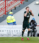 Liam Henderson scores goal no 2 for Celtic and celebrates by pointing to the heavens