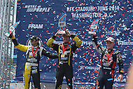 Washington, DC - June 22, 2014: Winners of the supercar final raise their trophies after the Red Bull Global Rallycross on the grounds of RFK Stadium in the District of Columbia, June 22, 2014. (L-R) Nelson Piquet, Jr., 3rd Place; Patrik Sandell, 1st Place; Joni Wiman, 2nd Place)  (Photo by Don Baxter/Media Images International)
