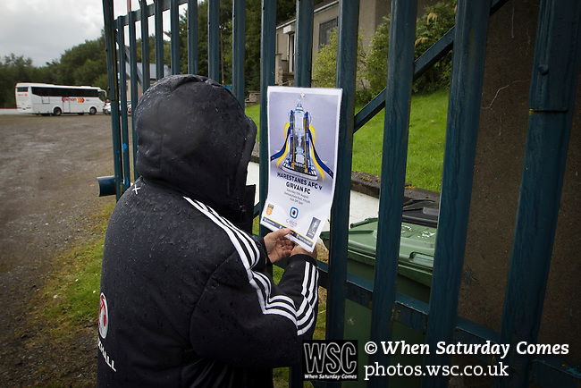 Harestanes AFC v Girvan FC, 15/08/2015. Scottish Cup preliminary round, Duncansfield Park. A club official attaching a poster to the main gate before Harestanes AFC take on Girvan FC in a Scottish Cup preliminary round tie, staged at Duncansfield Park, home of Kilsyth Rangers. The home team were the first winners of the Scottish Amateur Cup to be admitted directly into the Scottish Cup in the modern era, whilst the visitors participated as a result of being members of both the Scottish Football Association and the Scottish Junior Football Association. Girvan won the match by 3-0, watched by a crowd of 300, which was moved from Harestanes ground as it did not comply with Scottish Cup standards. Photo by Colin McPherson.