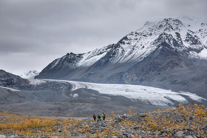 Hikers travel along the Gulkana Glacier in the Alaska Range mountains, Interior, Alaska.