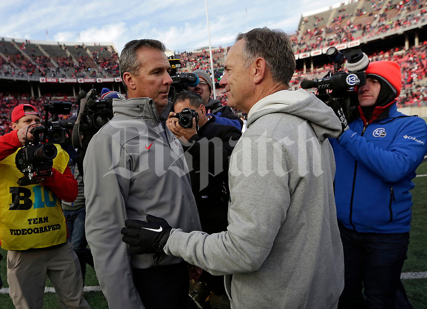 Ohio State Buckeyes head coach Urban Meyer shakes hands with Michigan State Spartans head coach Mark Dantonio following Ohio State's 48-3 win over Michigan State in the NCAA football game at Ohio Stadium in Columbus on Nov. 11, 2017. [Adam Cairns/Dispatch]