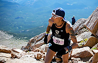 August 19, 2017 - Colorado Springs, Colorado, U.S. -  Colorado Springs runner, Gerald Romero, looks to the final boulder field near the summit of the 62nd running of the Pikes Peak Ascent.  The Ascent is a full half-marathon gaining over 7800 feet in elevation to reach the summit at 14,115 feet.  Mountain runners from around the world converge on Pikes Peak for two days of racing on America's Mountain in Colorado Springs, Colorado.