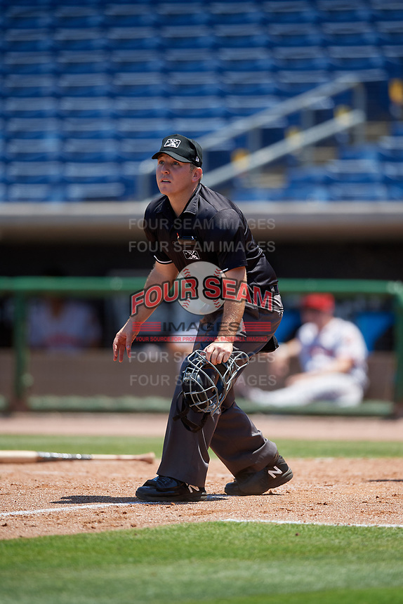 Umpire Louie Krupa tracks a fly ball down the line during a Florida State League game between the Florida Fire Frogs and Clearwater Threshers on April 24, 2019 at Spectrum Field in Clearwater, Florida.  Clearwater defeated Florida 13-1.  (Mike Janes/Four Seam Images)