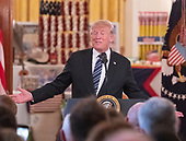 "United States President Donald J. Trump makes remarks after touring the White House ""Made in America Showcase"" in the Cross Hall of the White House in Washington, DC on Monday, July 23, 2018.<br /> Credit: Ron Sachs / CNP"
