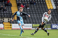 Jason McCarthy of Wycombe Wanderers clears the ball during the Sky Bet League 2 match between Notts County and Wycombe Wanderers at Meadow Lane, Nottingham, England on 28 March 2016. Photo by Andy Rowland.