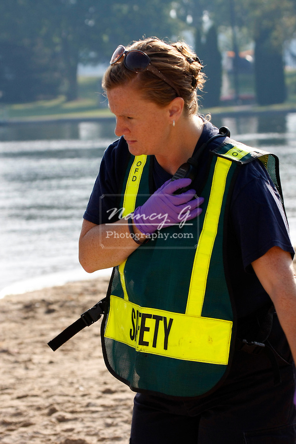 EMT safety officer at a scene of a mass casulty incident communicating on a radio