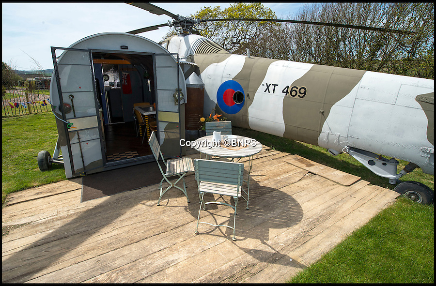 BNPS.co.uk (01202 558833)<br /> Pic: PhilYeomans/BNPS<br /> <br /> Scramble-ed eggs on the decking..<br /> <br /> Ultimate Heli-pad for a holiday - Campsite owner Stewart Dungey is hoping his new venture takes off - after turning a decommissioned Royal Navy helicopter into a unique holiday let.<br /> <br /> Stewart has spent £30,000 buying, transporting and converting a Cold War Westland Wessex chopper on his farm on the Isle of Wight<br /> <br /> With an Airstream caravan kitchen annex one side and a bedroom pod on the other the chopper now provides luxury accomodation for adventurous families.