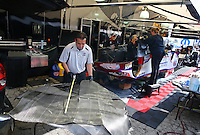 Feb 8, 2014; Pomona, CA, USA; Tony Pedregon works with crew members doing some fiberglass work on the NHRA funny car body during qualifying for the Winternationals at Auto Club Raceway at Pomona. Mandatory Credit: Mark J. Rebilas-
